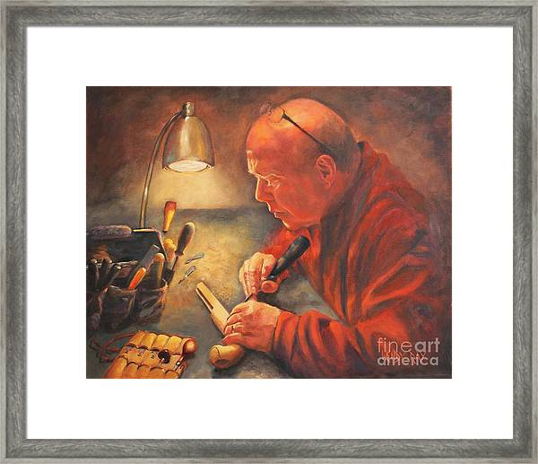The Gunsmith Framed Print