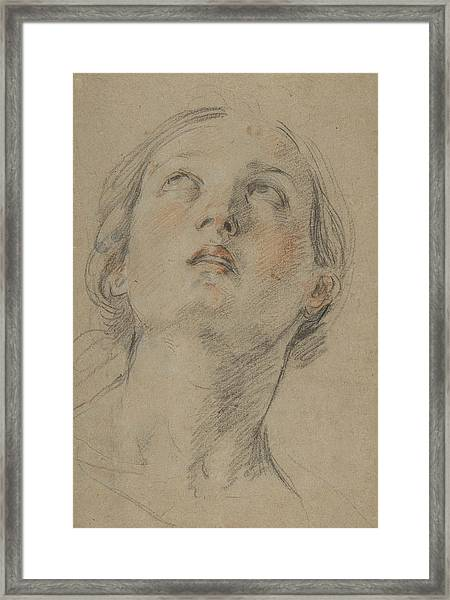 The Head Of A Woman Looking Up Framed Print