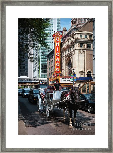 The Iconic Chicago Theater Sign And Traffic On State Street Framed Print