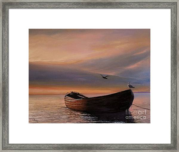 A Lone Boat Framed Print