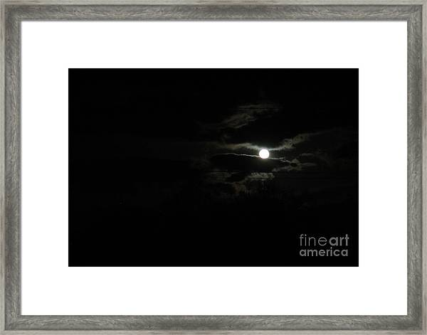 The Moon In Between Framed Print