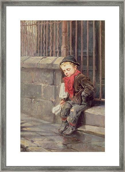 The News Boy Framed Print