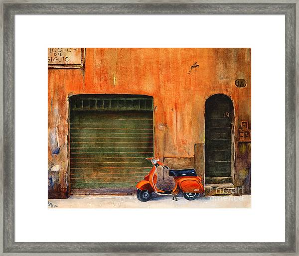 The Orange Vespa Framed Print