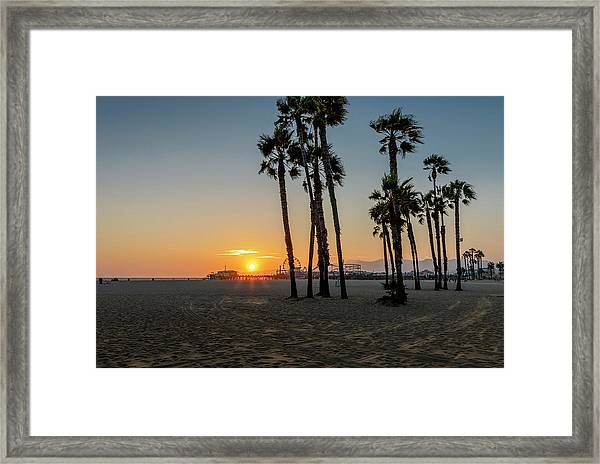The Pier At Sunset Framed Print