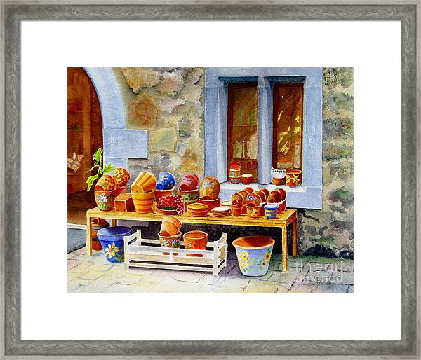 The Pottery Shop Framed Print