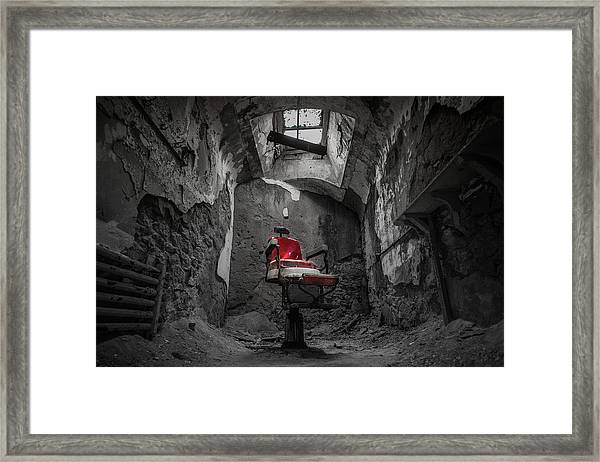 The Red Chair Framed Print