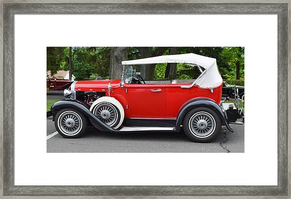 The Red Convertible Framed Print