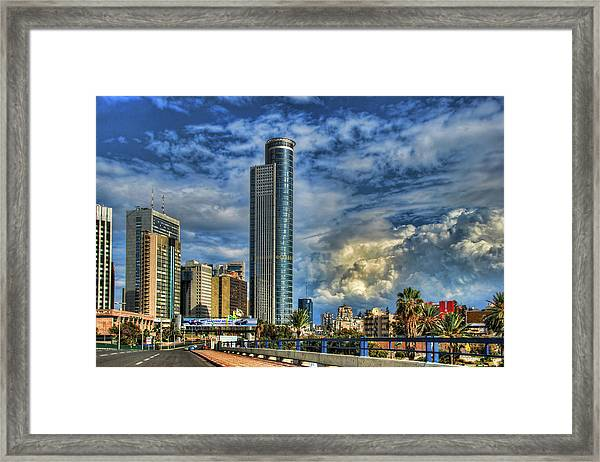 The Skyscraper And Low Clouds Dance Framed Print