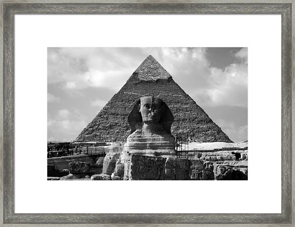 The Sphynx And The Pyramid Framed Print