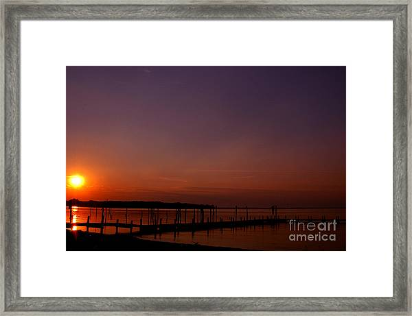 The Sun Sets Over The Water Framed Print