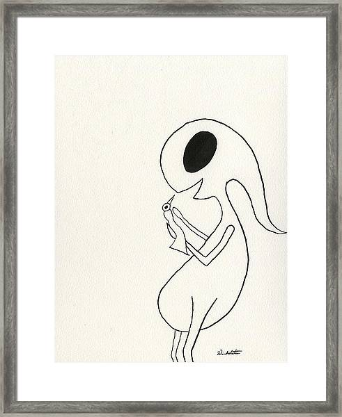 The Winkle Holding Bird Framed Print