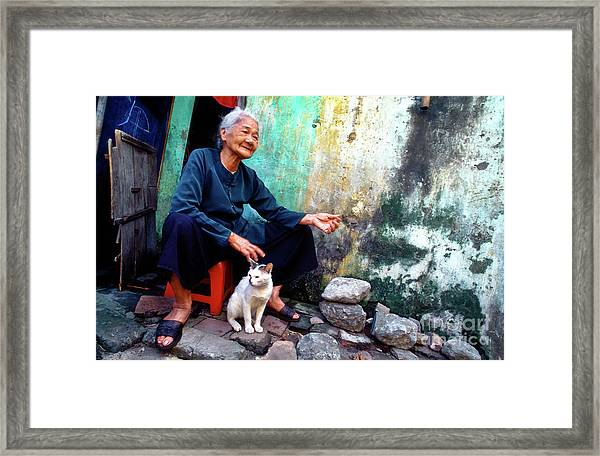 The Woman And The Cat Framed Print