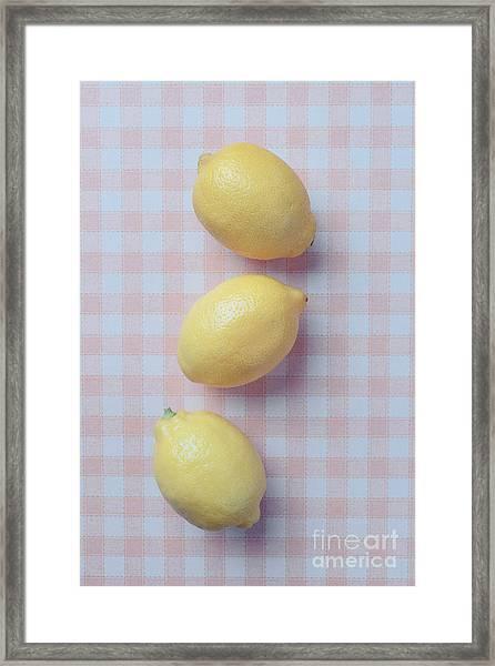 Three Lemons Framed Print