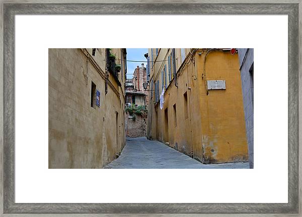 Tiny Street In Siena Framed Print