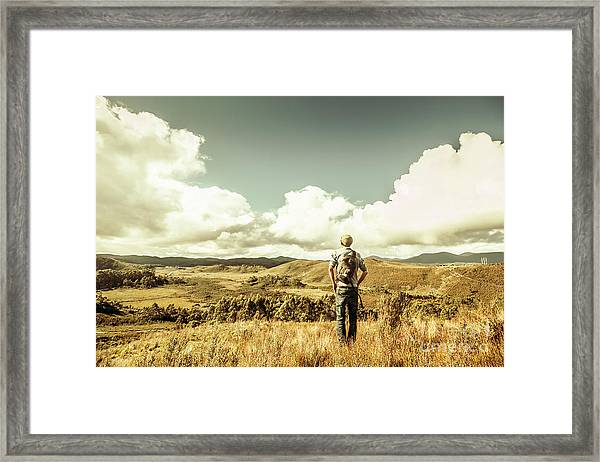 Tourist With Backpack Looking Afar On Mountains Framed Print