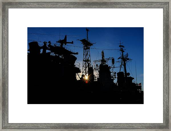 Towers And The Falling Sun Framed Print