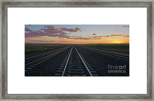 Tracks Into Sunset Framed Print