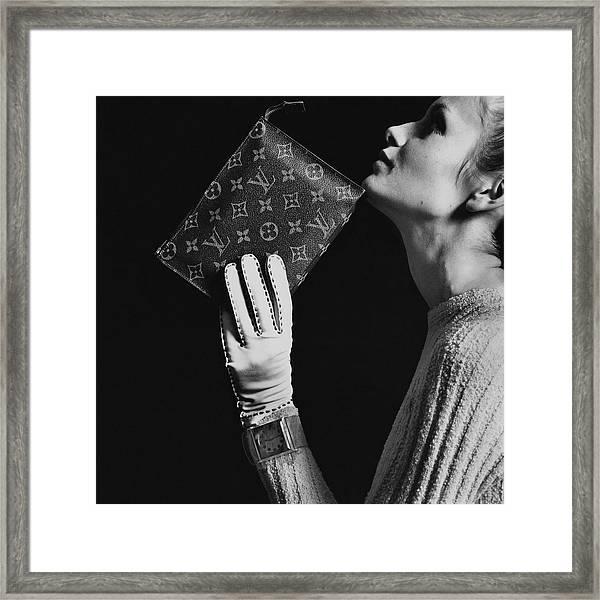Twiggy Holding Louis Vuitton Envelope Bag Framed Print