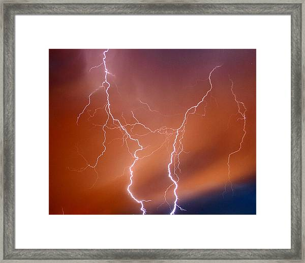 Twin Strike Framed Print