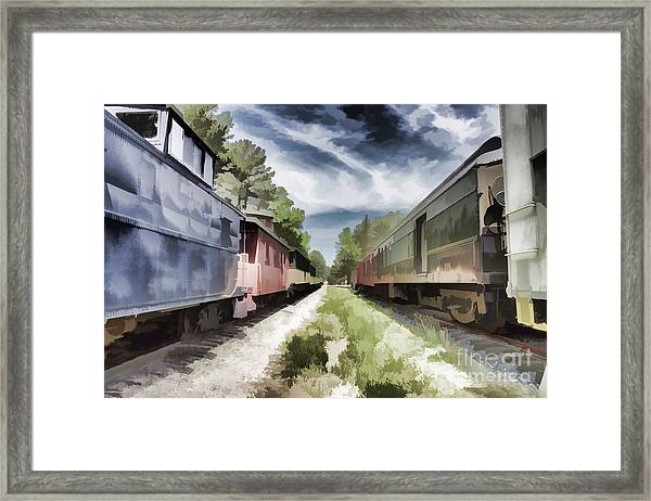 Twixt The Trains Framed Print