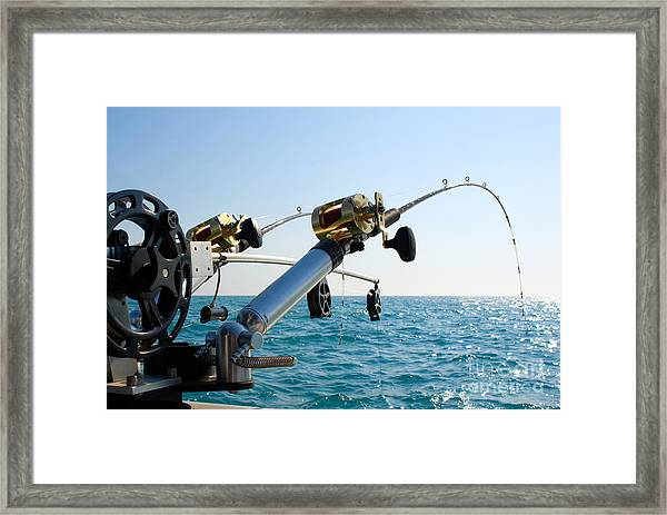 Two Fishing Poles On Back Of Boat Framed Print
