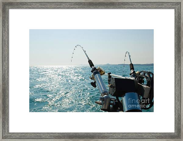 Two Fishing Rods On Back Of Boat Framed Print