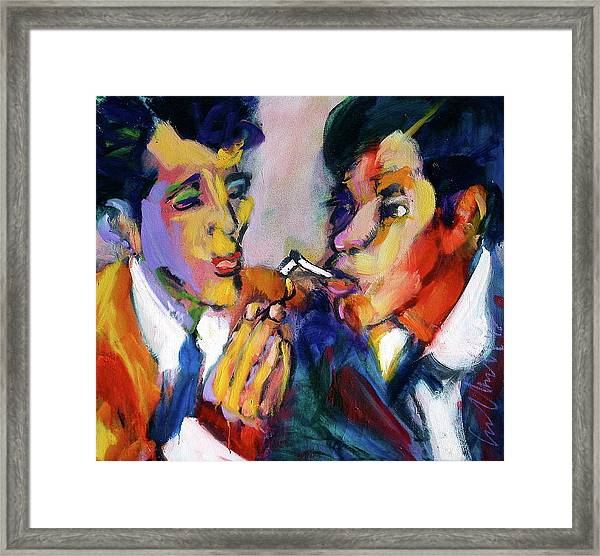 Two Men On A Match Framed Print