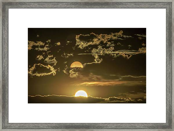 Two Suns Setting Framed Print