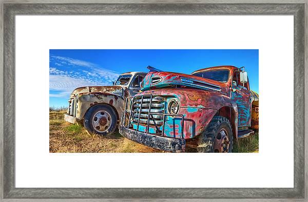 Two Trucks Framed Print