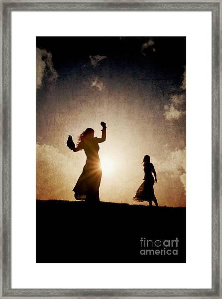 Two Women Dancing At Sunset Framed Print