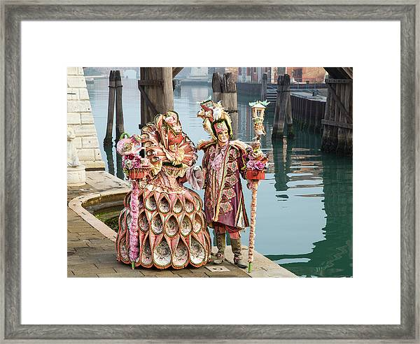 Venetian Couple Along The Canal Framed Print
