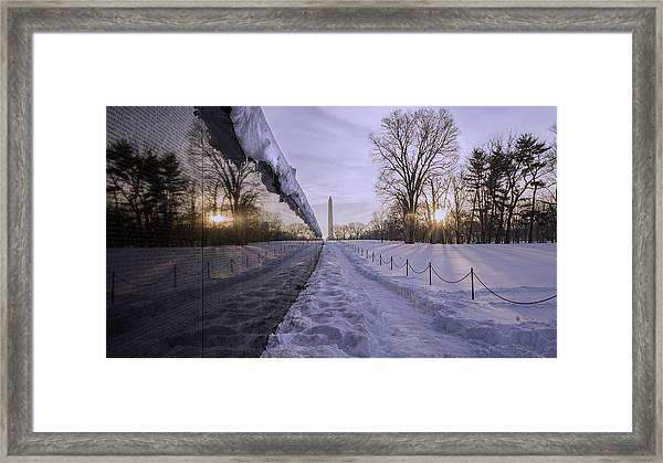 Vietnam Vetrans Memorial In Snow Framed Print by Michael Donahue