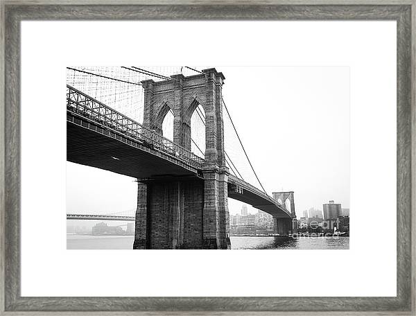 View Brooklyn Bridge With Foggy City In The Background Framed Print
