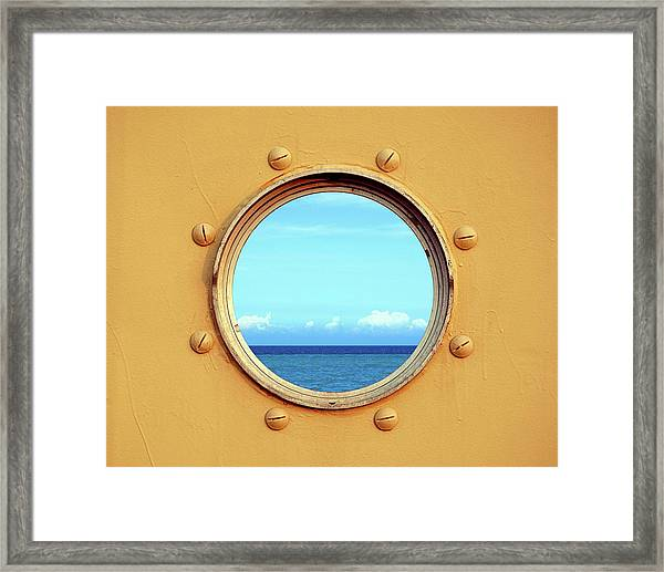 View Of The Ocean Through A Porthole Framed Print