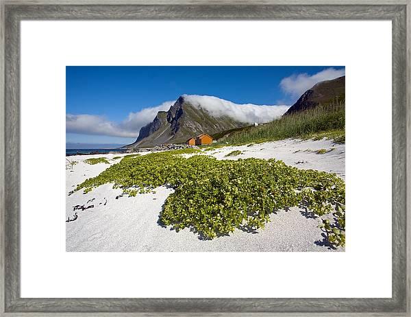 Vikten Beach With Green Grass, Mountains And Clouds Framed Print