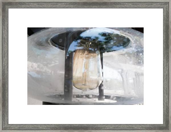 Vintage Light Bulb In An Old Glass Lantern In Sheboygan Wisconsin Framed Print