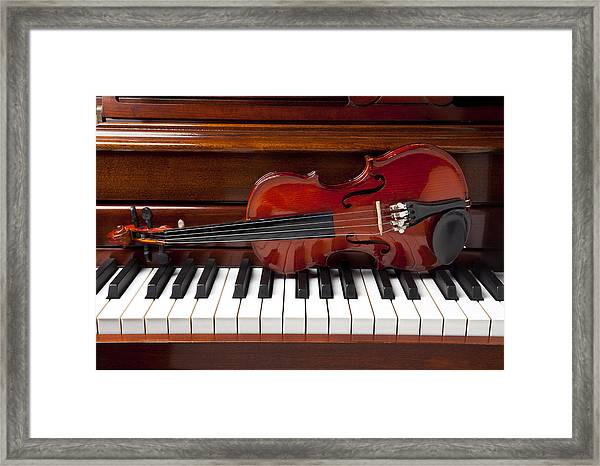 Violin On Piano Framed Print