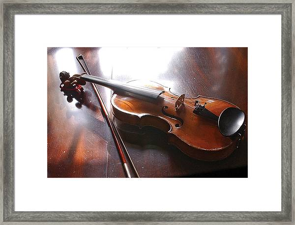 Violin On Table Framed Print