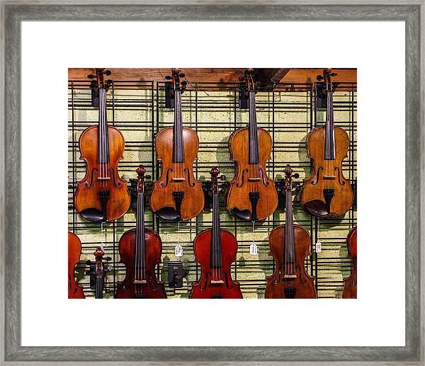 Violins In A Shop Framed Print