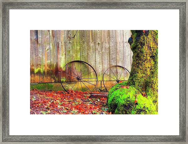 Framed Print featuring the photograph Wagon Wheels And Autumn Leaves by Dee Browning