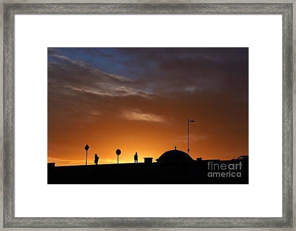 Walking At Sunset Framed Print