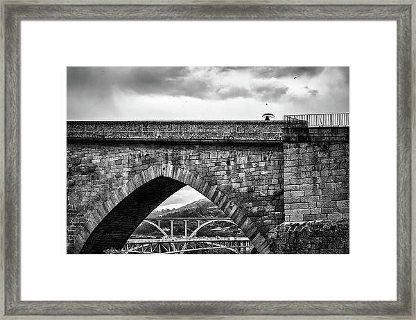 Walking On The Roman Bridge Framed Print