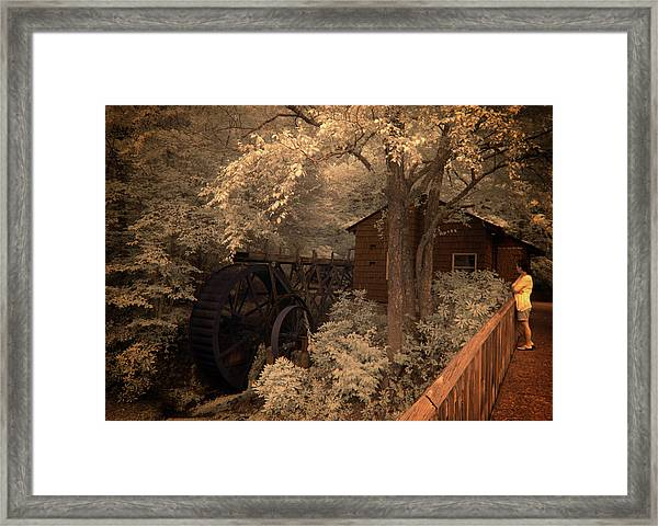 Watching The Wheels Framed Print