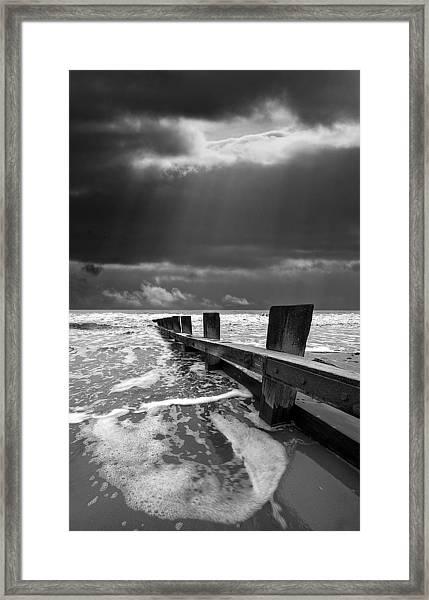 Wave Defenses Framed Print