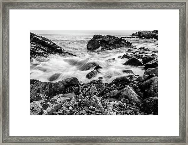 Waves Against A Rocky Shore In Bw Framed Print
