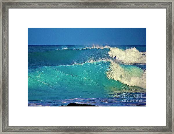 Waves And Surfer In Morning Light Framed Print