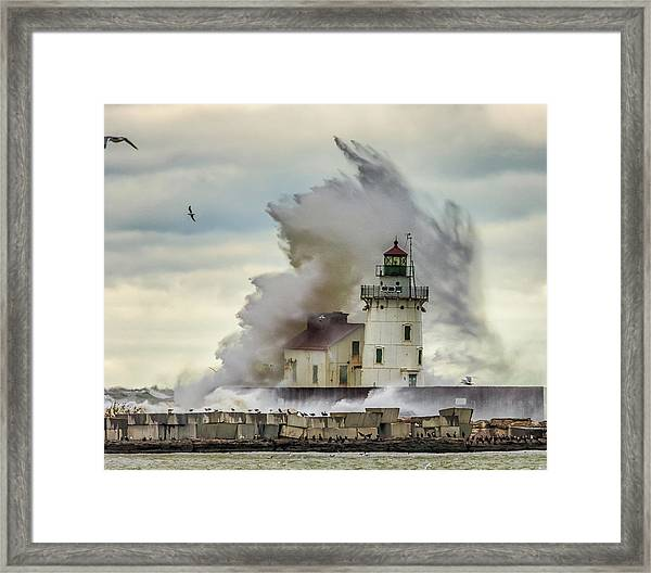 Waves Over The Lighthouse In Cleveland. Framed Print