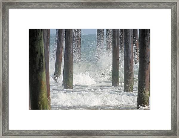 Waves Under The Pier Framed Print