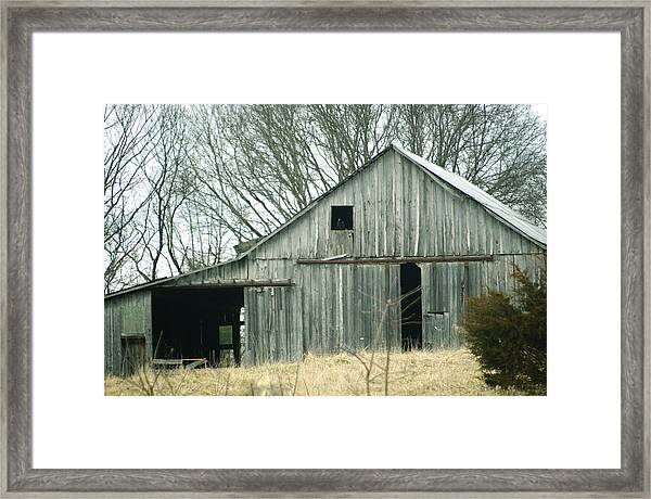 Weathered Barn In Winter Framed Print
