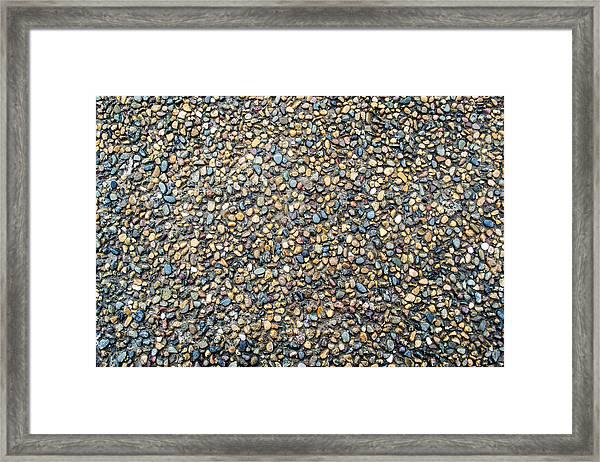 Wet Beach Stones Framed Print